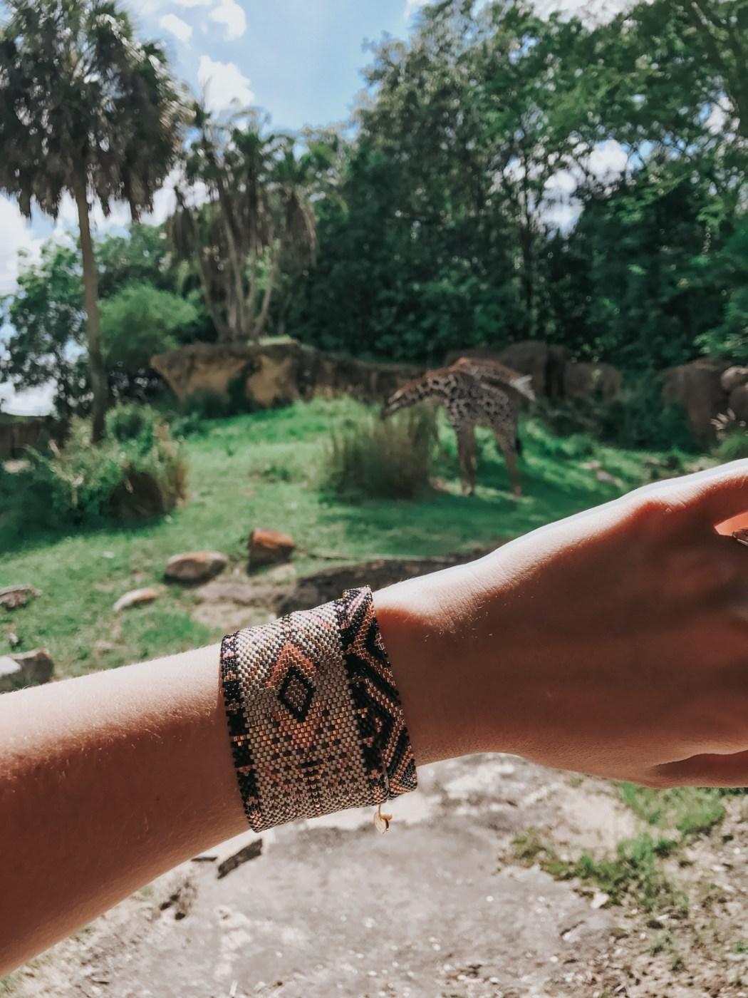 Showing off my @kutulakiss bracelets during the Kilimanjaro Safari at Animal Kingdom