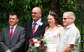 Keeley with husband and both brothers