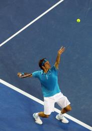 Roger Federer angling shoulders up at apex of the ball
