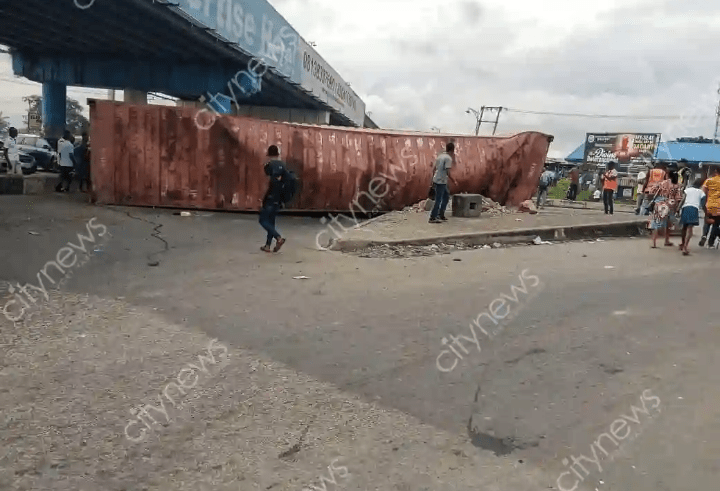 Driver, two others escape death as container falls under Eliozu flyover