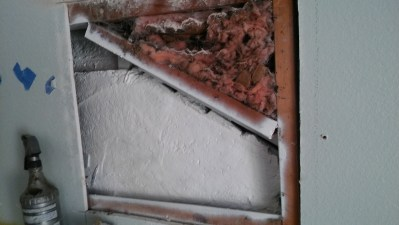 Inside of wall after removal of hive and treatment of space.