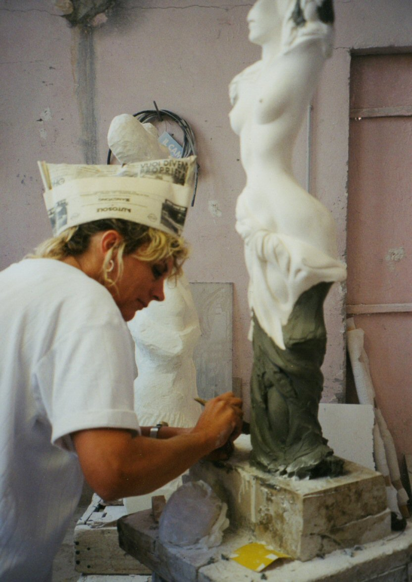 working on plaster model - Pietra Santa Italy