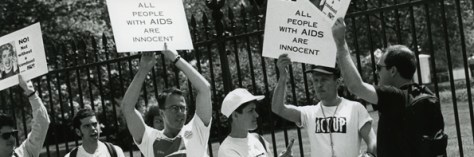 Protestors holding up signs that read, people with Aids are innocent