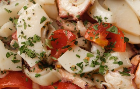 Appetizing homemade dish with squids and tomatoes