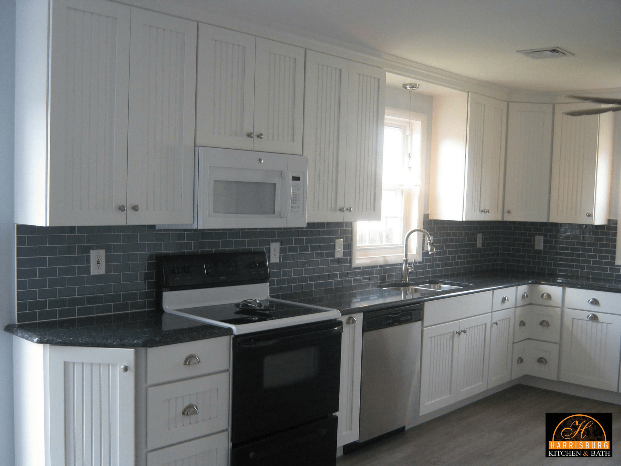 Retrofitting kitchen for over the range microwave for Adding crown molding to existing kitchen cabinets