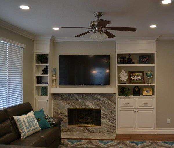 Built in entertainment center surrounding a custom fireplace.