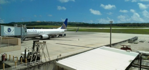 My plane at the gate in Guam. VIew from the UA club lounge