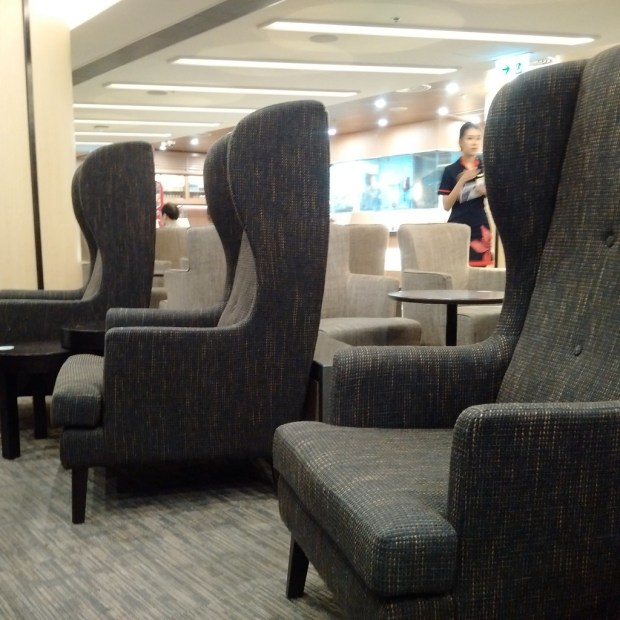 HK Airlines lounge tall backed chairs