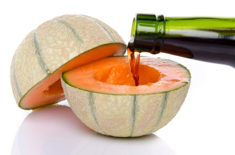 Porto wine poured into a melon