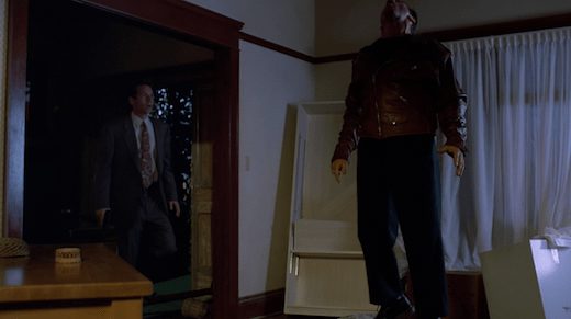 Mulder walks in and sees one of Lauren's assailants hanging in mid-air.