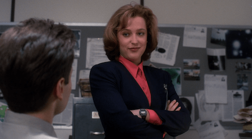Scully smirks at Mulder.
