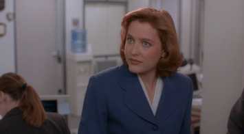 Scully gives Mulder a jealous look.