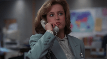 Scully talks on the phone with Mulder.