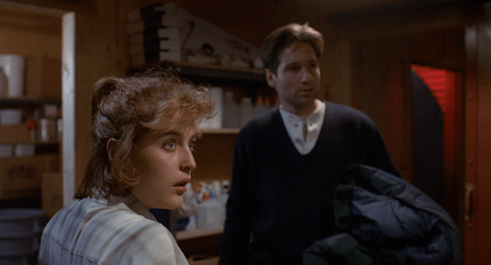 Scully looks at Hodge in outrage when he accuses her of being infected.
