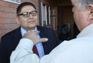 Norwalk City Council candidate Enrique Aranda listens to voter during a recent campaign event.  Randy Economy Photo