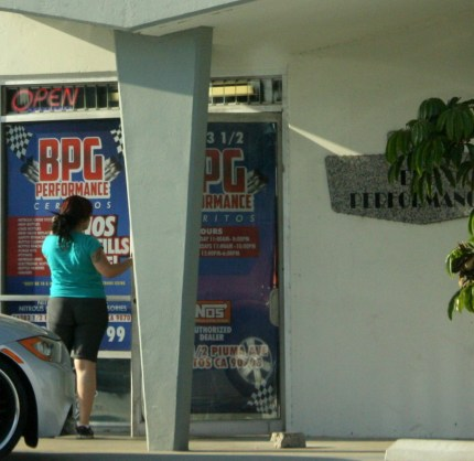A female attempts to enter BPG in Cerritos on Friday afternoon during a raid on the location for the sales of nitrous oxide.  Randy Economy Photo
