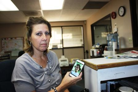 Norwalk resident Sherry Ortiz holds a cell phone photo of her son Daniel Ortiz who was killed in February of this year.