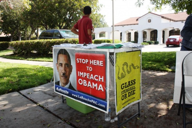 Obama protester Ed Ciampini sets up at Cerritos Post Office on Carmenita Road and 183rd Street on Monday morning. Photo by Randy Economy