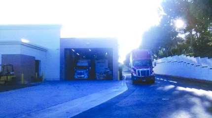 Delivery trucks line up at new Wal Mart Market in Cerritos.
