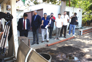 """Broken Pipes Create Backyard """"Jacuzzi""""- Assemblyman Jimmy Gomez [right]and State Senator Roger Hernandez [second from right] inspect the back yard of a home owned by Caltrans where a broken pipe has created what area neighbors refer to as the """"Jacuzzi."""" Randy Economy Photo."""