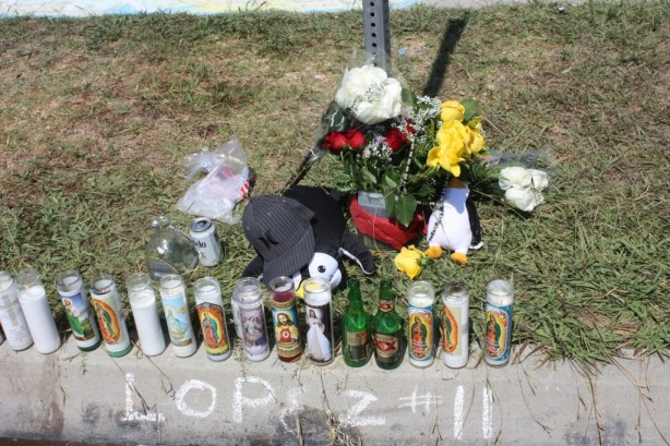 A memorial for Sergio Lopez, 29 of Artesia grows in front of his home on 180th Street.