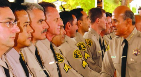 Los Angeles County Sheriff Lee Baca seen at a previous inspection of Deputies at the Cerritos Sheriff's Station.  Baca announced that he is stepping down as Sheriff amid controversy on January 31.   Randy Economy Photo