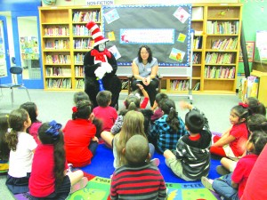 Assemblywoman Cristina Garcia reads to kindergarten students in the classroom of her former teacher Ms. Ponce-Edgington.