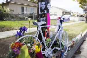 A white bicycle, photos, notes and candles are placed at the scene of the crash in honor of Norwalk residents Giovanni Chaidez and Rosibel Montoya who died as a result of being struck by a vehicle.  Pete Parker Photo