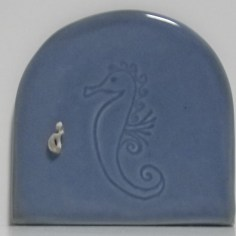 five inch blue fairy door embossed with a seahorse and embellished with a seashell doorknob