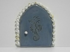 5 inch blue fairy door embossed with a seahorse and embellished with shells