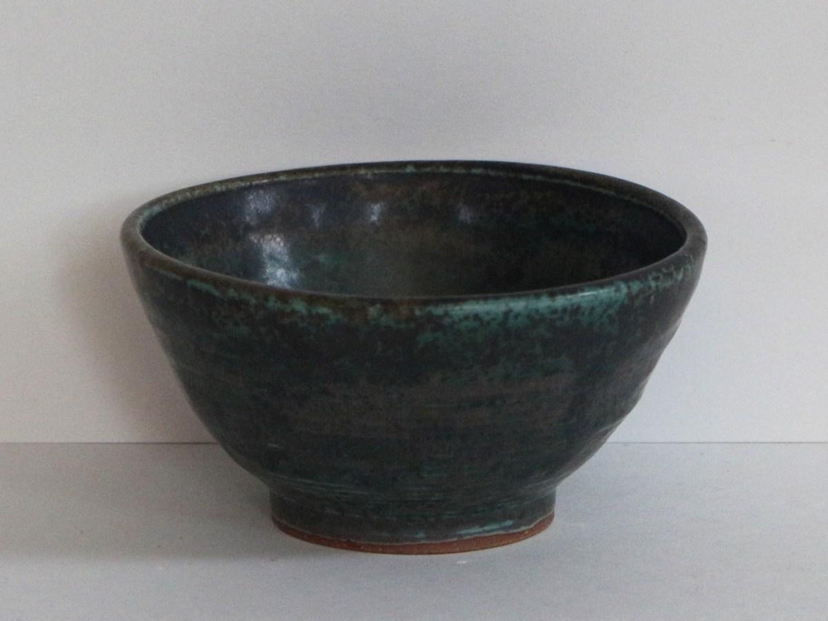 small black-green bowl, unavailable