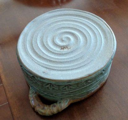 underside of small round casserole dish