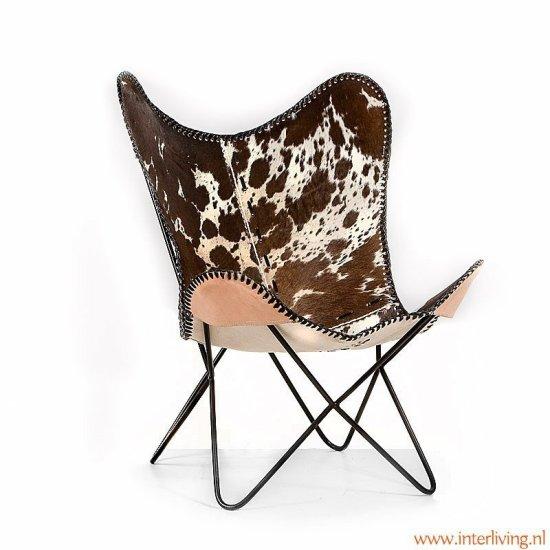 vlinderstoel, BFK chair, Mariposa chair, zwart onderstel, stalen frame, koeienhuid, zitting koeienhuid, zwart, bruin, wit.
