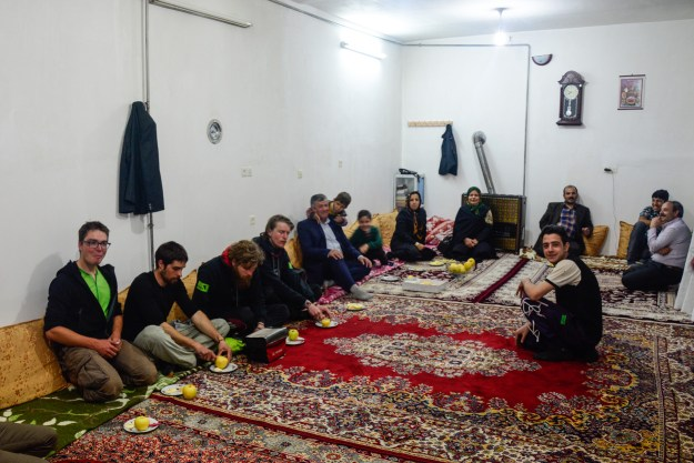 Iranian room, Iranian carpets and European cyclists trying to fold their legs in various ways to sit on them