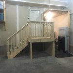 Vertical Platform Lift in Garage with Front and Back On _ Off Points