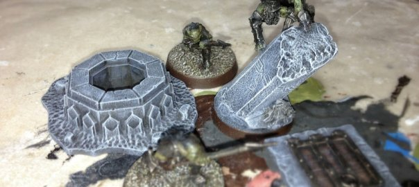 A selection of goblin miniatures along with dwarven stonework