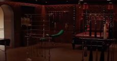 A red velvet room filled with BDSM equipment.