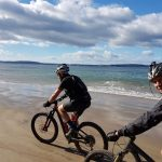 Deserted beach biking in Hobart, Tasmania
