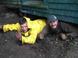 Replacing a building foundation in the rain ain't  for sissies... Yet Tim and Harrison emerge from the underworld with smiles.
