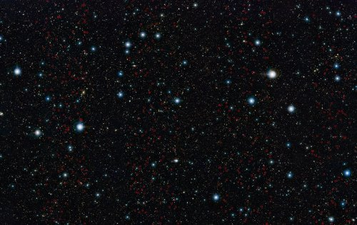 ESO's VISTA survey telescope has spied a horde of previously hidden massive galaxies that existed when the Universe was in its infancy. By discovering and studying more of these galaxies than ever before, astronomers have for the first time found out exactly when such monster galaxies first appeared. The newly discovered massive galaxies are marked on this image of the UltraVISTA field.