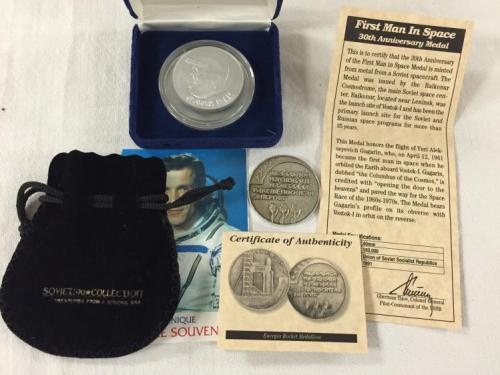 "Three (3) ""Flown"" Russian Space Program souvenirs; a cosmonaut-endorsed flown Soyuz alloy card and two nice medallions"