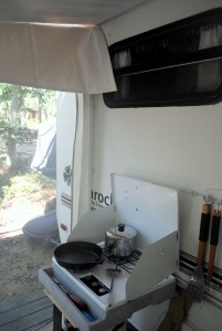 Our main kitchen for the summer. Cooking indoors will never be the same. The kitchen sink was a garden hose.