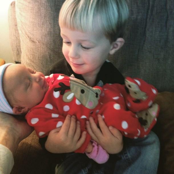 jm holding newborn scarlett