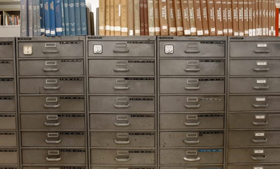 Filing cabinet system with books color organized on top