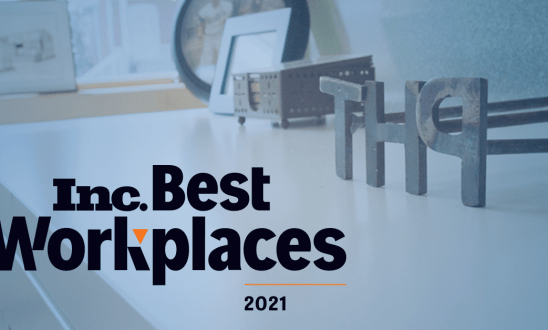 Inc. Best Workplaces 2021 text over a transparent blue background with a table at Hodges with T, H, P in brand letters aligned in a row