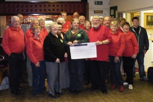 TARCA committee members and Wollerton Bowling Club members witness the handing over of the grant.