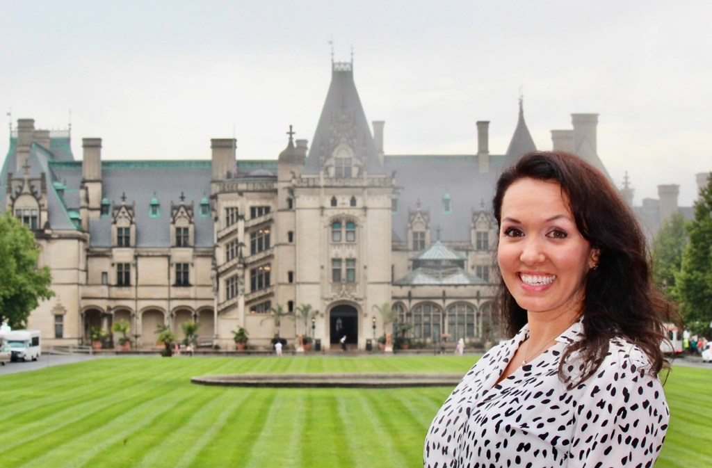 Monica poses at The Biltmore, one of the most amazing mansions in the USA.  Biltmore Castle is one of the top ten things to do in North Carolina.  Best thing to do in Asheville, North Carolina.