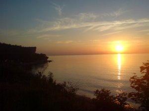 Solnedgång över viken