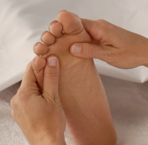 heal sore feet with massage