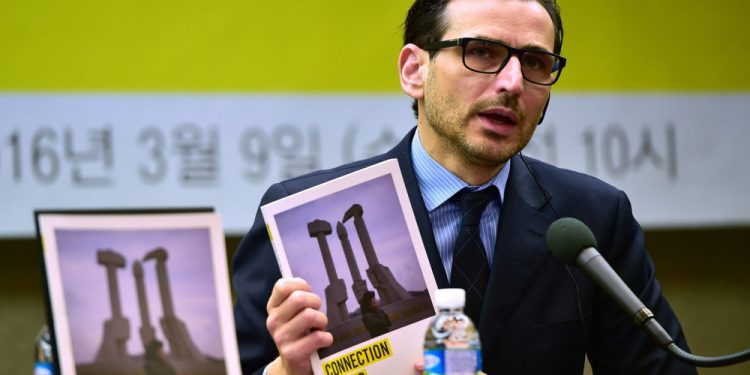 Amnesty East Asia regional director Nicholas Bequelin speaks during a press conference on restrictions on mobile phones and outside information in North Korea, in Seoul on March 9, 2016.  North Korea is cracking down on the private use of mobile phones to make international calls, as the authorities seek to bolster its citizens' isolation from the outside world, Amnesty International said. / AFP / JUNG YEON-JE